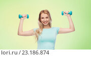 Купить «smiling beautiful young sporty woman with dumbbell», фото № 23186874, снято 30 апреля 2016 г. (c) Syda Productions / Фотобанк Лори