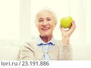 Купить «happy senior woman with green apple at home», фото № 23191886, снято 10 июля 2015 г. (c) Syda Productions / Фотобанк Лори