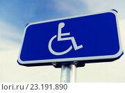 Купить «close up of road sign for disabled outdoors», фото № 23191890, снято 5 ноября 2015 г. (c) Syda Productions / Фотобанк Лори