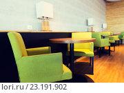 Купить «restaurant interior with tables and chairs», фото № 23191902, снято 5 ноября 2015 г. (c) Syda Productions / Фотобанк Лори