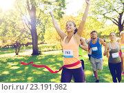 Купить «happy young female runner winning on race finish», фото № 23191982, снято 16 августа 2015 г. (c) Syda Productions / Фотобанк Лори