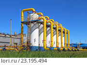 Купить «Газопровод на фоне безоблачного синего неба», фото № 23195494, снято 3 июля 2016 г. (c) Григорий Писоцкий / Фотобанк Лори