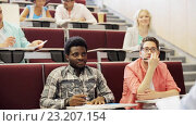 Купить «group of students with notebooks in lecture hall», видеоролик № 23207154, снято 23 июня 2016 г. (c) Syda Productions / Фотобанк Лори