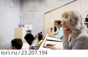 Купить «group of students and teacher in lecture hall», видеоролик № 23207194, снято 23 июня 2016 г. (c) Syda Productions / Фотобанк Лори