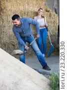 Купить «Young man standing with metallic spade», фото № 23220330, снято 21 февраля 2019 г. (c) Яков Филимонов / Фотобанк Лори
