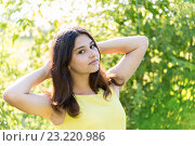 Купить «Portrait of 14 year old girl outdoors on a sunny day», фото № 23220986, снято 2 июля 2016 г. (c) Володина Ольга / Фотобанк Лори