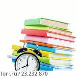 Купить «Alarm clock and stack of books», фото № 23232870, снято 21 июня 2015 г. (c) Типляшина Евгения / Фотобанк Лори