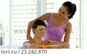 Купить «Fitness trainer advising her customer», видеоролик № 23242870, снято 29 мая 2020 г. (c) Wavebreak Media / Фотобанк Лори