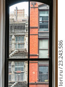 Купить «Flatiron District, Manhattan, New York City. Looking through a Window in a Cast Iron Building at a partial view of two more cast iron buildings across the street.», фото № 23243586, снято 30 мая 2016 г. (c) age Fotostock / Фотобанк Лори