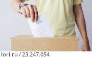 Купить «man putting his vote into ballot box on election», видеоролик № 23247054, снято 2 июля 2016 г. (c) Syda Productions / Фотобанк Лори