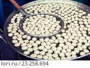 Купить «meat or rice balls frying in oil at street market», фото № 23258694, снято 7 февраля 2015 г. (c) Syda Productions / Фотобанк Лори