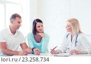 Купить «doctor with patients in cabinet», фото № 23258734, снято 6 июля 2013 г. (c) Syda Productions / Фотобанк Лори
