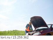 Купить «woman with open hood of broken car at countryside», фото № 23259362, снято 28 мая 2016 г. (c) Syda Productions / Фотобанк Лори