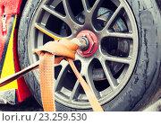 Купить «close up of race car wheel with tow rope tied to», фото № 23259530, снято 15 октября 2015 г. (c) Syda Productions / Фотобанк Лори