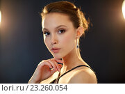 beautiful young asian woman with diamond earring. Стоковое фото, фотограф Syda Productions / Фотобанк Лори