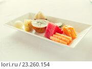 Купить «plate of fresh juicy fruit dessert at restaurant», фото № 23260154, снято 21 февраля 2015 г. (c) Syda Productions / Фотобанк Лори