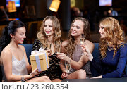 Купить «happy women with champagne and gift at night club», фото № 23260354, снято 21 ноября 2015 г. (c) Syda Productions / Фотобанк Лори