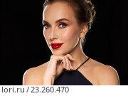 Купить «beautiful woman in black over dark background», фото № 23260470, снято 14 апреля 2016 г. (c) Syda Productions / Фотобанк Лори