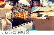Купить «close up of cook frying meatballs at street market», фото № 23260850, снято 7 февраля 2015 г. (c) Syda Productions / Фотобанк Лори