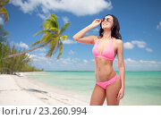 Купить «happy woman in pink bikini swimsuit on beach», фото № 23260994, снято 14 апреля 2015 г. (c) Syda Productions / Фотобанк Лори