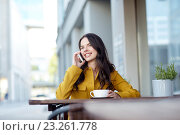 Купить «happy woman calling on smartphone at city cafe», фото № 23261778, снято 12 мая 2016 г. (c) Syda Productions / Фотобанк Лори