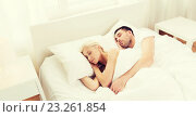 Купить «happy couple sleeping in bed at home», фото № 23261854, снято 6 июня 2015 г. (c) Syda Productions / Фотобанк Лори