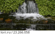 Купить «Небольшой водопад», видеоролик № 23266058, снято 25 мая 2019 г. (c) Александр Перепелицын / Фотобанк Лори