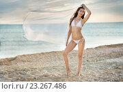 Купить «Beautiful girl in a swimsuit on the beach», фото № 23267486, снято 3 июля 2016 г. (c) Типляшина Евгения / Фотобанк Лори