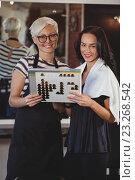 Купить «woman hairdresser stylist helps to choose the color of paint for hair», фото № 23268542, снято 22 мая 2016 г. (c) Wavebreak Media / Фотобанк Лори