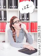 Купить «Женщина зевает на рабочем месте», фото № 23288518, снято 29 июня 2016 г. (c) Darkbird77 / Фотобанк Лори
