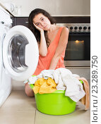 Купить «Sad woman using washing machine at home», фото № 23289750, снято 31 марта 2020 г. (c) Яков Филимонов / Фотобанк Лори