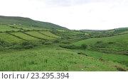 Купить «farmland field at wild atlantic way in ireland 74», видеоролик № 23295394, снято 25 июня 2016 г. (c) Syda Productions / Фотобанк Лори