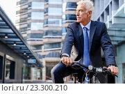 Купить «Successful businessman riding bicycle», фото № 23300210, снято 8 февраля 2015 г. (c) Sergey Nivens / Фотобанк Лори