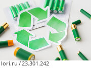 Купить «close up of batteries and green recycling symbol», фото № 23301242, снято 3 июня 2016 г. (c) Syda Productions / Фотобанк Лори