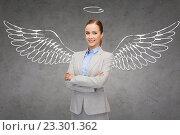 Купить «happy businesswoman with angel wings and nimbus», фото № 23301362, снято 14 февраля 2014 г. (c) Syda Productions / Фотобанк Лори