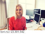 Купить «happy creative female office worker with computers», фото № 23301542, снято 29 марта 2015 г. (c) Syda Productions / Фотобанк Лори