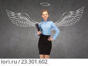 Купить «happy businesswoman with angel wings and nimbus», фото № 23301602, снято 14 февраля 2014 г. (c) Syda Productions / Фотобанк Лори