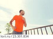 Купить «happy man with earphones running outdoors», фото № 23301834, снято 5 июля 2015 г. (c) Syda Productions / Фотобанк Лори
