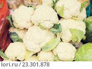 Купить «close up of cauliflower at street market», фото № 23301878, снято 27 июля 2015 г. (c) Syda Productions / Фотобанк Лори