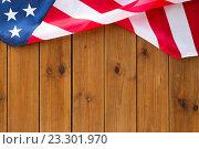 Купить «close up of american flag on wooden boards», фото № 23301970, снято 6 мая 2016 г. (c) Syda Productions / Фотобанк Лори