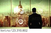 Купить «Businessman looking at digitally generated text and graphic on office window», видеоролик № 23310802, снято 23 ноября 2019 г. (c) Wavebreak Media / Фотобанк Лори