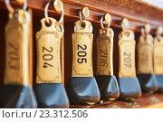 Купить «hotel keys with room numbers hanging at reception», фото № 23312506, снято 9 июля 2016 г. (c) Дмитрий Калиновский / Фотобанк Лори