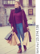 Купить «Portrait of young girl with bags from her shopping», фото № 23314138, снято 18 июня 2019 г. (c) Яков Филимонов / Фотобанк Лори