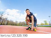 Купить «Спортивный мальчик-подросток с гантелями на стадионе», фото № 23320190, снято 30 апреля 2016 г. (c) Сергей Новиков / Фотобанк Лори