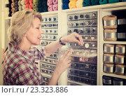 Купить «mature woman in sewing store», фото № 23323886, снято 23 мая 2019 г. (c) Яков Филимонов / Фотобанк Лори