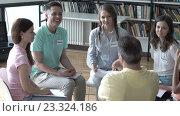 Купить «People with name badges on therapy», видеоролик № 23324186, снято 27 июля 2016 г. (c) Raev Denis / Фотобанк Лори