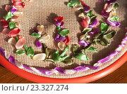 Купить «Рукоделие. Вышивка атласными лентами на канве в круглых пяльцах», фото № 23327274, снято 29 июля 2016 г. (c) Виктория Катьянова / Фотобанк Лори