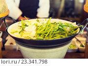 Купить «bowl of green salad or garnish at asian restaurant», фото № 23341798, снято 15 февраля 2015 г. (c) Syda Productions / Фотобанк Лори