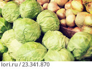 Купить «close up of cabbage and onion at street market», фото № 23341870, снято 27 июля 2015 г. (c) Syda Productions / Фотобанк Лори