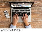 Купить «close up of hands with laptop and smartphone», фото № 23342034, снято 10 октября 2014 г. (c) Syda Productions / Фотобанк Лори